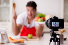 The food blogger working in the kitchen. Food blogger working in the kitchen Royalty Free Stock Photography