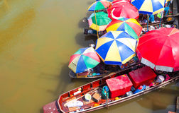 Food boat with colorful umbrella at Ampawa royalty free stock photo