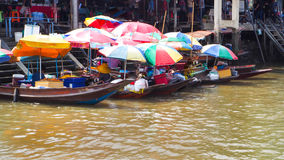 Food boat with colorful umbrella at Ampawa Royalty Free Stock Photography