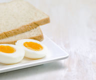 Boiled egg and toasts on white plate Stock Photo