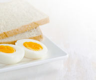 Boiled egg and toasts on white plate Stock Image