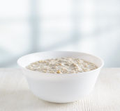 Bowl of oat porridge Stock Images
