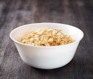 Bowl of oatmeal on wooden table Royalty Free Stock Photos