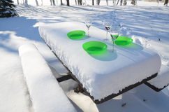 Food bowls on frozen picnic bench Stock Photo