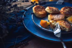 Food. Breakfast. Cheesecakes in a plate decorated with oranges stock photography