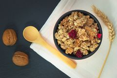 Food breakfast concept Organic Muesli or Granola and milk with napkin. On black slate stone plate stock images