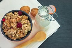 Food breakfast concept Organic Muesli or Granola and milk with napkin. On black slate stone plate royalty free stock photos