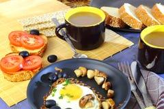 Food, breakfast. Scrambled eggs, toast, tomatoes, marinated mush stock photography
