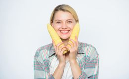 Food bring happiness. Woman hold yellow corn cob white background. Corn harvest. Girl hold ripe corn. Food vegetarian. And healthy natural organic products stock photo