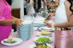 Food Buffet Catering Dining Eating Party Sharing Concept. People group catering buffet food indoor in luxury restaurant with meat colorful fruits and vegetables stock images
