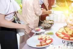 Food Buffet Catering Dining Eating Party Sharing Concept. People group catering buffet food indoor in luxury restaurant with meat colorful fruits and vegetables stock image