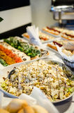Food buffet with finger-food and salads Stock Photos