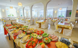Food buffet. Platters and dishes of Food set up for a large catered dinner or lunch buffet Stock Photos
