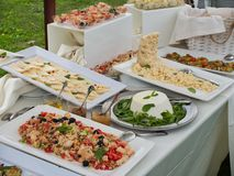 Food or buffet and table set at ceremony or event garden. Food or buffet and table set at ceremony or event in the garden stock photo