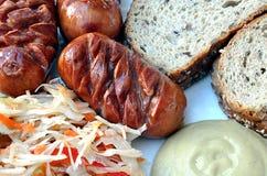 Food - cabbage, sausage, mustard, bread Stock Photos