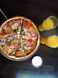 Food cafe. Pizza, juice, sayce Stock Photo
