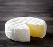 Camembert cheese on a wooden board Stock Photos