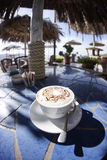 Food: Cappuccino at the beach Stock Photography