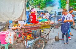 The food cart with grilled chicken in Mahanak Fruit Market of Bangkok, Thailand