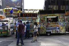 Food Carts. New York, NY USA --August 3, 2016  A line forms at one of many food carts in Times Square. Editorial Use Only Royalty Free Stock Photo