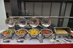 Food catering in buffet style at Thai restaurant. Food, catering, self-service and eating concept - Buffet food serving on metallic tray. Prepare for wedding royalty free stock images