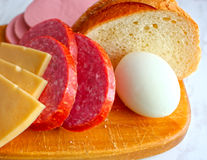 Food cheese sausage meat, fast, rural breakfast en route. Outdoors Stock Photos