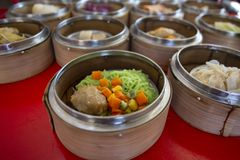 Food Chinese dim sum in a bamboo steamer box sphere,Concept:Traditional Asian appetizer culture,Delicious China food festival menu. Top viw stock photography