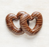 Chocolate hearts on white wooden table. Valentines Royalty Free Stock Photos