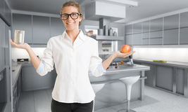 Food choice. Young woman in a kitchen holding an apple with one hand and a can in the other stock photo
