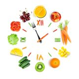 Food clock with fresh fruits and vegetables Stock Photo