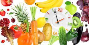 Food clock with fruits and vegetables Royalty Free Stock Photography