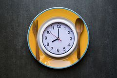 Food clock. Healthy food concept Stock Photo