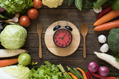 Food clock. Healthy food concept. On wooden table Royalty Free Stock Photos