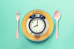 Food clock spoon and fork stock photo