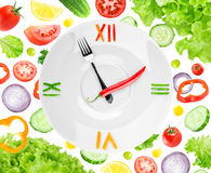 Food clock with vegetables Stock Photos