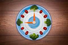 Food clock with vegetables, Healthy food concept Stock Photos