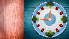 Food clock with vegetables, Healthy food concept Royalty Free Stock Photo