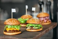 Food. Closeup Burgers And Hamburgers In Fast Food Restaurant. Food. Closeup Burgers And Hamburgers On Table In Fast Food Restaurant. High Resolution Royalty Free Stock Image
