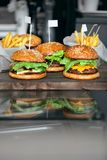 Food. Closeup Burgers And Hamburgers In Fast Food Restaurant. Food. Closeup Burgers And Hamburgers On Table In Fast Food Restaurant. High Resolution Stock Photography