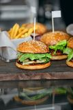 Food. Closeup Burgers And Hamburgers In Fast Food Restaurant. Food. Closeup Burgers And Hamburgers On Table In Fast Food Restaurant. High Resolution Royalty Free Stock Photo