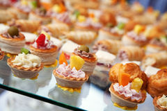 Food for cocktail on wedding party. At hotel stock photo