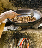 Coffee beans are roasting in pan Stock Photos