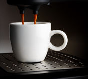 Coffee machine pouring a cup of espresso Royalty Free Stock Photos