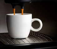 Coffee machine pouring a cup of espresso Stock Photography