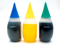 Food Coloring. 3 tubes of food coloring : blue, yellow, green on a while surface stock images