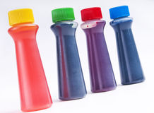 Food coloring. Four bottles of food coloring dye on a white background royalty free stock image