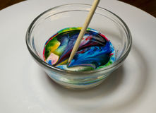 Food Coloring Art in Milk Kids Activity Stock Photo