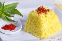 Food combinations, saffron rice. Royalty Free Stock Photo
