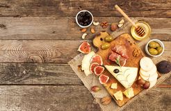 Food composition with cheese plate with cheese, dry meats, vario Royalty Free Stock Image