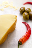 Food composition of chili pepper, green olives and cheese. Royalty Free Stock Photo